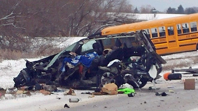 A sport utility vehicle collided with a Ronan school bus on U.S. Highway 93 Monday just north of Ronan. The driver of the sport utility vehicle died. None of the children were seriously injured. (Don Bell/ Lake County Sheriff via AP)