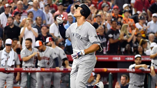 Aaron Judge rounds the bases after his home run in the second inning.