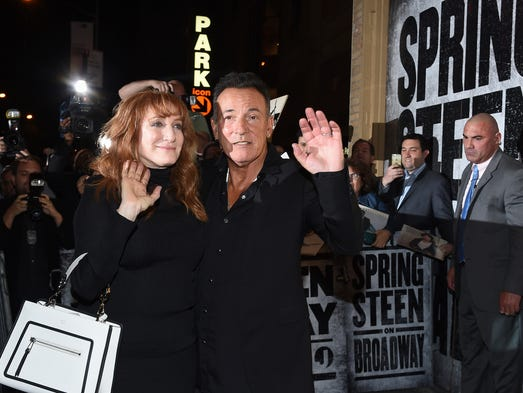 Bruce Springsteen and his wife Patti Scialfa exit out