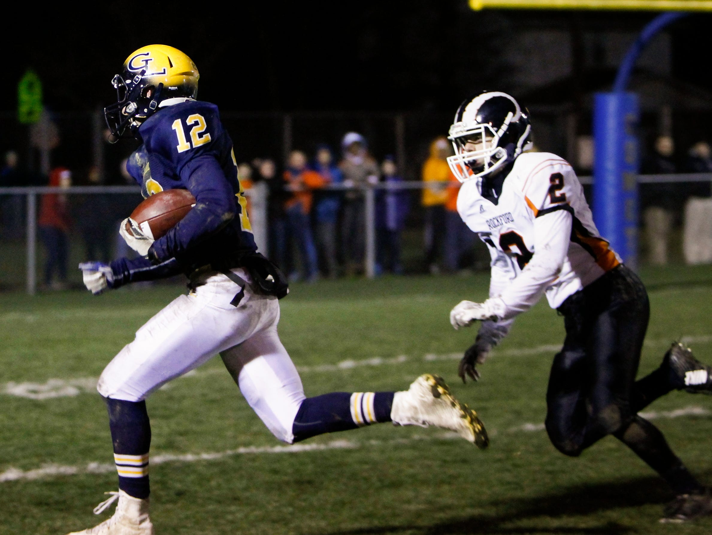 Grand Ledge senior Luke Lalumia heads into the end zone for a touchdown, tying the score 16-16 in the fourth quarter against Rockford Friday, November 13, 2015, during the Div. 1 regional final at Grand Ledge. Grand Ledge won 36-16.