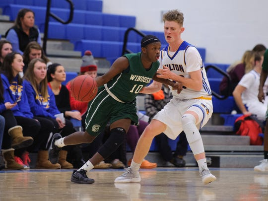 Winooski's Andy Siki (10) dribbles the ball past Milton's Ian Jennings (23) during the boys basketball game between the Winooski Spartans and the Milton Yellowjackets at Milton high school on Thursday night December 14, 2017 in Milton.