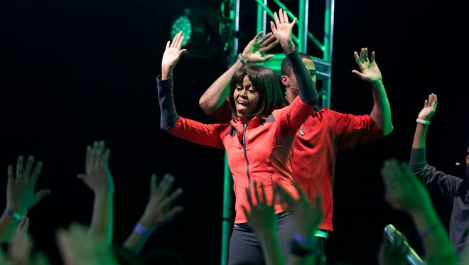 First lady Michelle Obama exercises with children from Chicago Public Schools, in Chicago on Feb. 28, 2013.