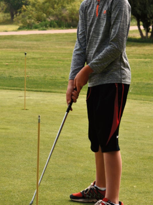 Matt Hollinshead — Current-Argus David Bluth, 10, putts toward the end of Thursday's Carlsbad Cavemen and Cavegirl junior golf camp session at Lake Carlsbad Golf Course.