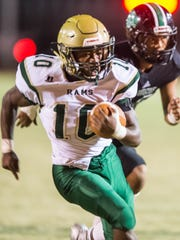 Acadiana High's Dillan Monette (10) gets to the outside for the touchdown against the Lafayette High Mighty Lions Friday Nov. 3, 2017.