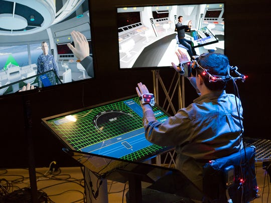 A technician uses virtual reality to test out new military