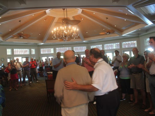 Bill Heck, 96, left, is greeted by friends at the La Playa Golf Club early February. Members put on 'Bill Heck Day' to honor the World War II vet and starter at the golf club.