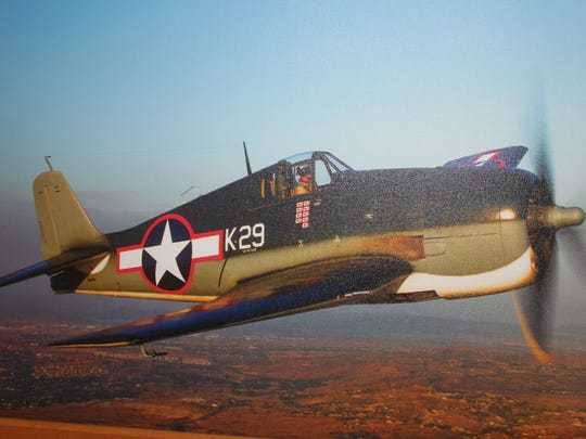 A canvas photo of a Hellcat plane flown during World War II. This was a gift from La Playa Golf Club members to Bill Heck, a World War II vet, who flew the plane for the U.S. Navy. He's worked at the country club since 2003 as a starter.