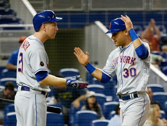 New York Mets' Todd Frazier, left, congratulates Michael