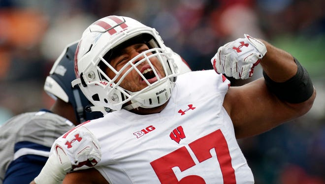 Wisconsin linebacker Alec James (57) has agreed to a deal with the Arizona Cardinals.