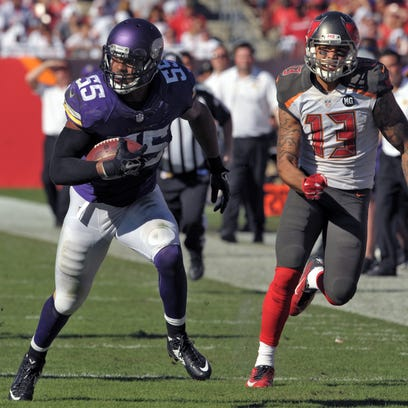 Vikings linebacker Anthony Barr (55) runs past Tampa Bay wide receiver Mike Evans (13) after picking up a fumble during a game last season. Barr was the Vikings' first round pick in last year's draft.