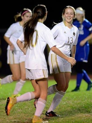 Savannah Getz of Merritt Island gets congratulated by teammates after her goal in Thursday's regional quarterfinal against Sebring.