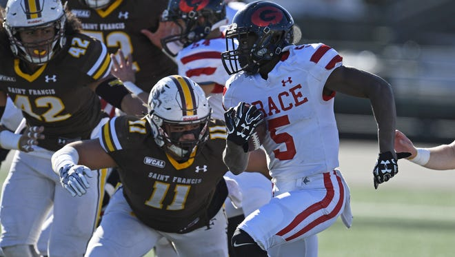 Grace Brethren running back Seven McGee eludes the St. Francis defense en route to a first-quarter touchdown run in the CIF Division 2-A state championship bowl at Sacramento State on Saturday afternoon. The Lancers lost 22-13.