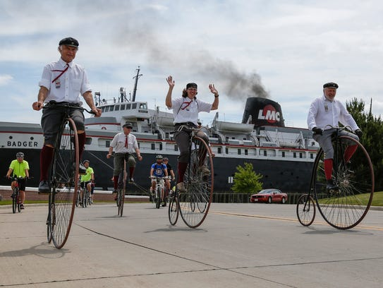 The Wheelmen lead a group ride by the S.S. Badger June