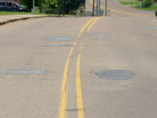 The portion of Lane Avenue in front of Jackson Central-Merry High School has potholes forming.
