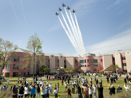 Five Blue Angels' jets from the U.S. Navy Flight Demonstration Squadron fly over Valley Children's Hospital in Madera on Wednesday, March 16, 2016. The squadron's signature six-jet F/A-18 Hornet Delta Formation, led by Navy Cmdr. Ryan Bernacchi, was en route to their next air show in Lancaster, Ca.