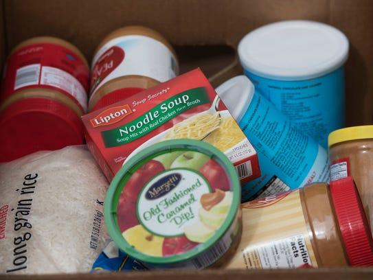 Krewe members collect donated food Sunday, January