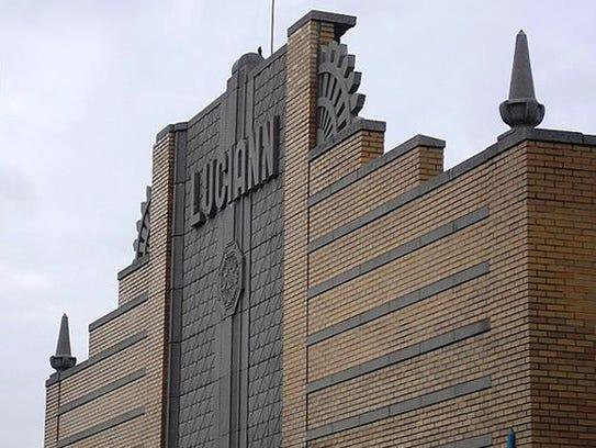 The ornate upper facade of the Paris Adult Theatre