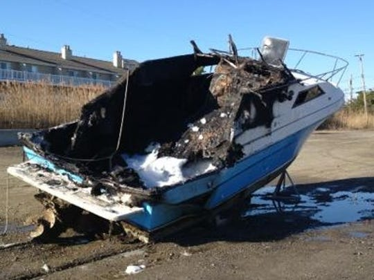 Fire melted this boat at the Barnegat docks on Sunday morning.
