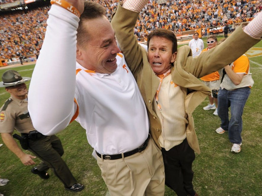 Vols coach Butch Jones celebrates with athletic director Dave Hart after Tennessee beat South Carolina 23-21 at Neyland Stadium on Oct. 19, 2013.