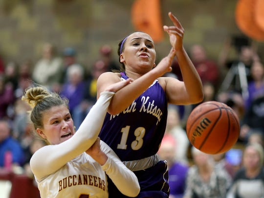 North Kitsap girls basketball player Olivia Selembo is stripped of the ball as she goes for a lay-in by Kingston player Avy Hiner Friday night at Kingston.