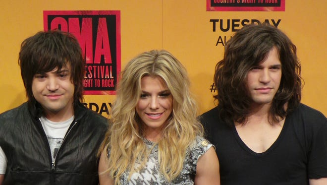 Neil, left, Kimberly and Reid Perry of the Band Perry at the CMA Music Festival in Nashville on June 6, 2014.