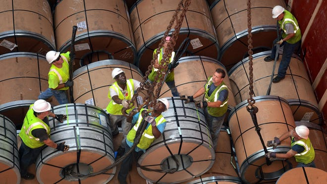 Workers secure multiple-ton coils of steel for unloading by crane from the cargo ship Selinda at the Logistec USA terminal at the Adm. Harold E. Shear State Pier in New London, Conn., in July. The Selinda was just the 11th cargo ship handled at the New London pier this year.