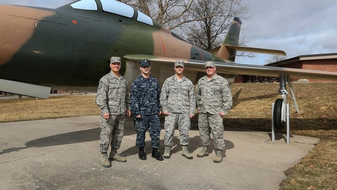 Tim Cochran, left, poses for a photo with his sons (from left), Caleb, Brandon, and Cheyenne next to a F-84 Thunderstreak on Thursday, Feb. 25, 2016, at the Gold Star Military Museum in Johnston.
