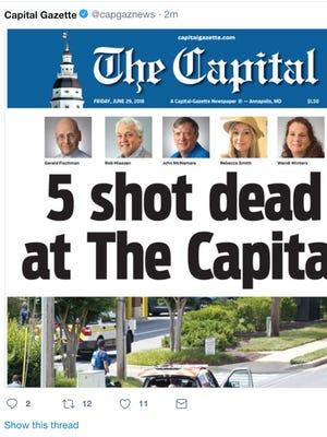 A tweet from the Capital Gazette shows the paper's Friday edition front page, a day after a gunman killed 5 of the paper's employees.