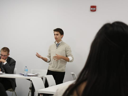 Gavin Bleir,a senior at Vestal High School and a student at BOCES' New Visions Law and Government program, addresses Broome Country Executive Jason Garnar's Student Board of Advisers.