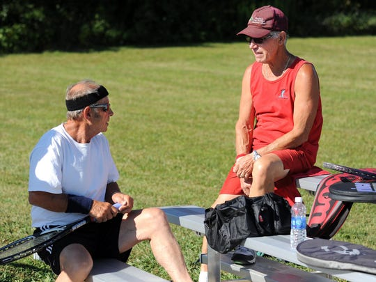 Floyd Farmer and Allen Clady discuss the next team matchup Thursday afternoon at the Bucyrus Community Tennis Courts. The Tennis Crew have been playing twice a week at Bucyrus Community Tennis Courts for 40 years.