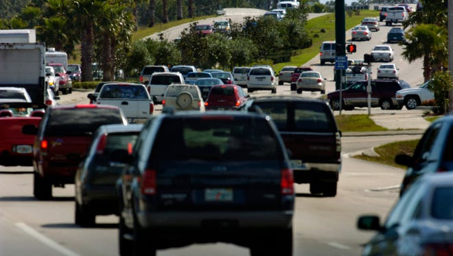 Traffic flow begins to back up along St. Lucie West Boulevard at the Florida Turnpike overpass in Port St. Lucie.