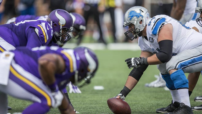 Sep 20, 2015; Minneapolis, MN, USA; Lions center Travis Swanson about to snap the ball against the Minnesota Vikings.