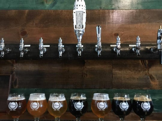 Beer taps with the state Capitol building atop one of the handles at Ellison Brewery & Spirits.