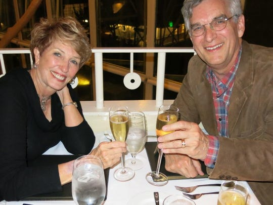 Shreveporters Glenda and Neil Erwin toast a wedding anniversary from a few years ago.