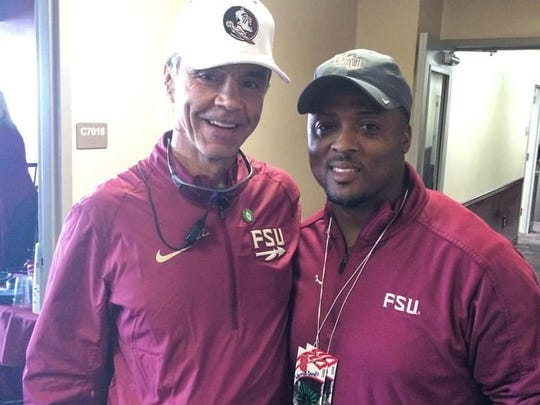 Monk Bonasorte, left, pictured with Warrick Dunn at Florida State's home football game Saturday.