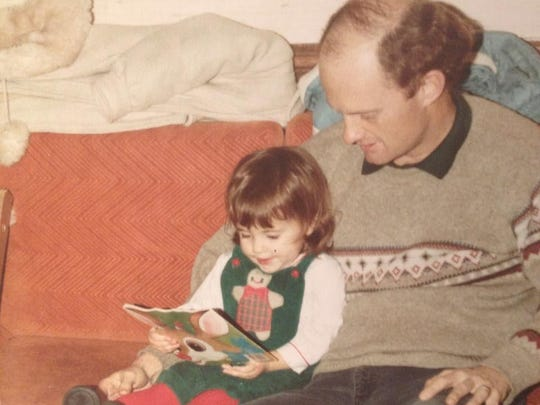 Liz Whalen Tallent of The Orange Peel reads a Christmas story with father Pat Whalen many years ago.