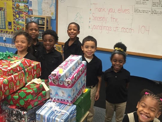 Students at the Pontiac Academy for Excellence look forward to opening gifts.