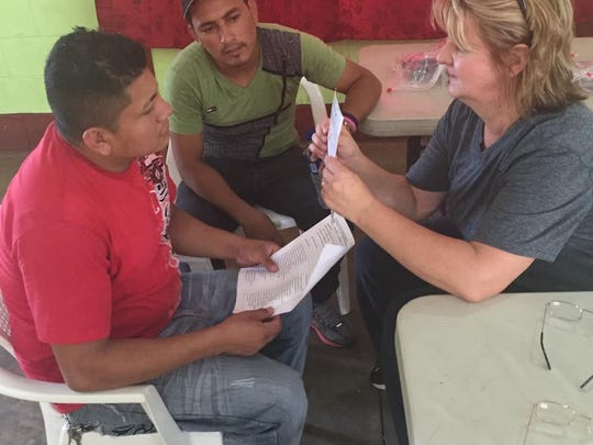 A volunteer works with patients in the eye clinic in León, Nicaragua, last month.