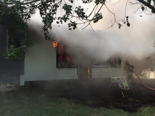 The house on Nine Mile in Lyon Township was fully involved when firefighters arrived.
