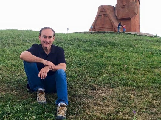 "Chris Bohjalian last month with the symbol for the Armenian Republic of Nagorno-Karabakh, Grandma and Grandpa: ""We are our mountains."""
