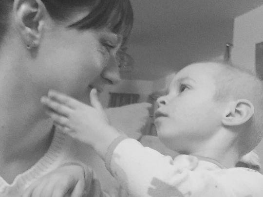 Dawn Aversa shares a tender moment with daughter Elena, 2, who is battling cancer.