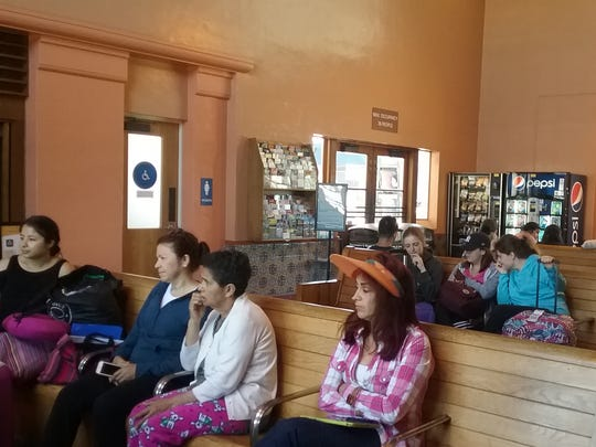 Rail passengers wait for the arrival of Salinas' only passenger train, the Coast Starlight, in the newly renovated Salinas Amtrak station Wednesday.