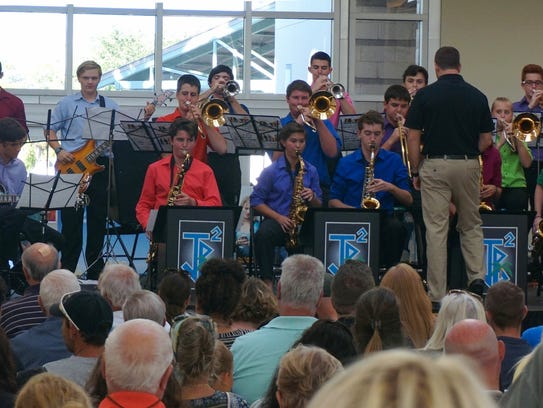 The Jensen Beach High School Band performs at the 2017