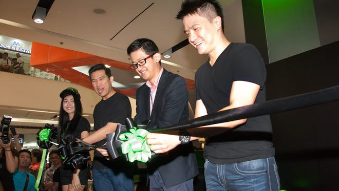 Min-Liang Tan, Razer's co-founder and CEO, at right, at the opening of the RazerStore in Manila, Phillippines in May 2016.