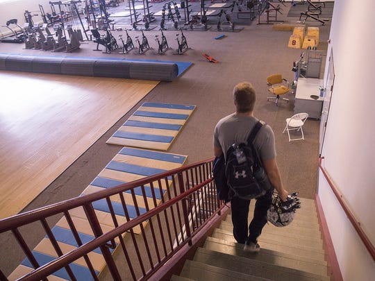 Karl Barback enters the weight room at his former high