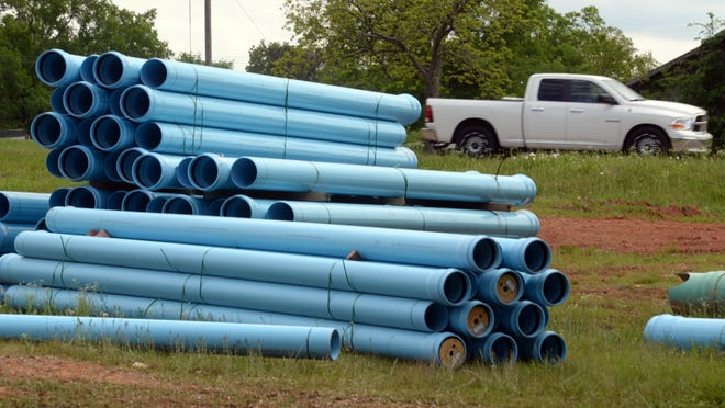 Sewage lines are collected in a pile along La 80 in Haughton recently. Bossier City may transfer operational control of its water and sewer facilities to a private company.