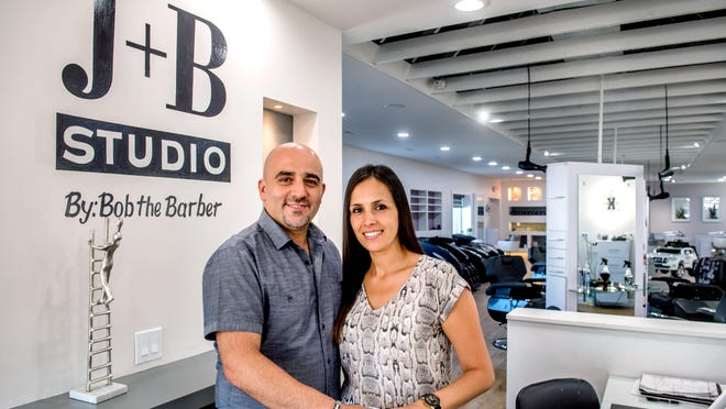Bob and Joyce Khoury pose in the new location of their barbershop and salon J+B Studio By Bob The Barber, 2302 W. Glen Ave. in Peoria.