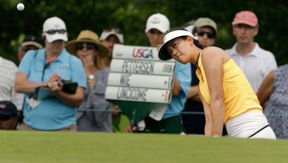 Michelle Wie chips onto the seventh green during the