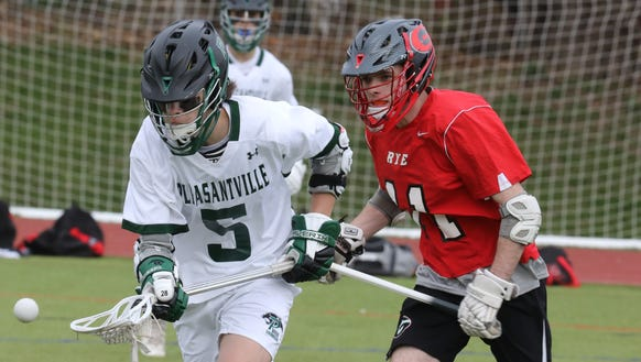Rye's Tyler Freilich (11) guards Pleasantville's Pat Doherty (5) during boys lacrosse game at Pleasantville High School on April 24, 2018. Pleasantville defeats Rye 13-9.