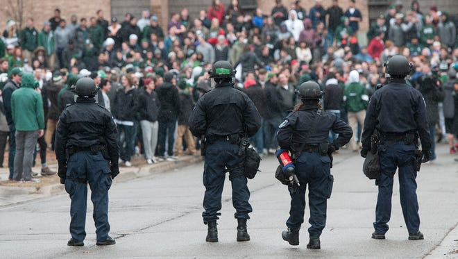 Police show a limited presence in Cedar Village in East Lansing after a crowd gathered after the MSU Spartans advanced to the Final Four Sunday.